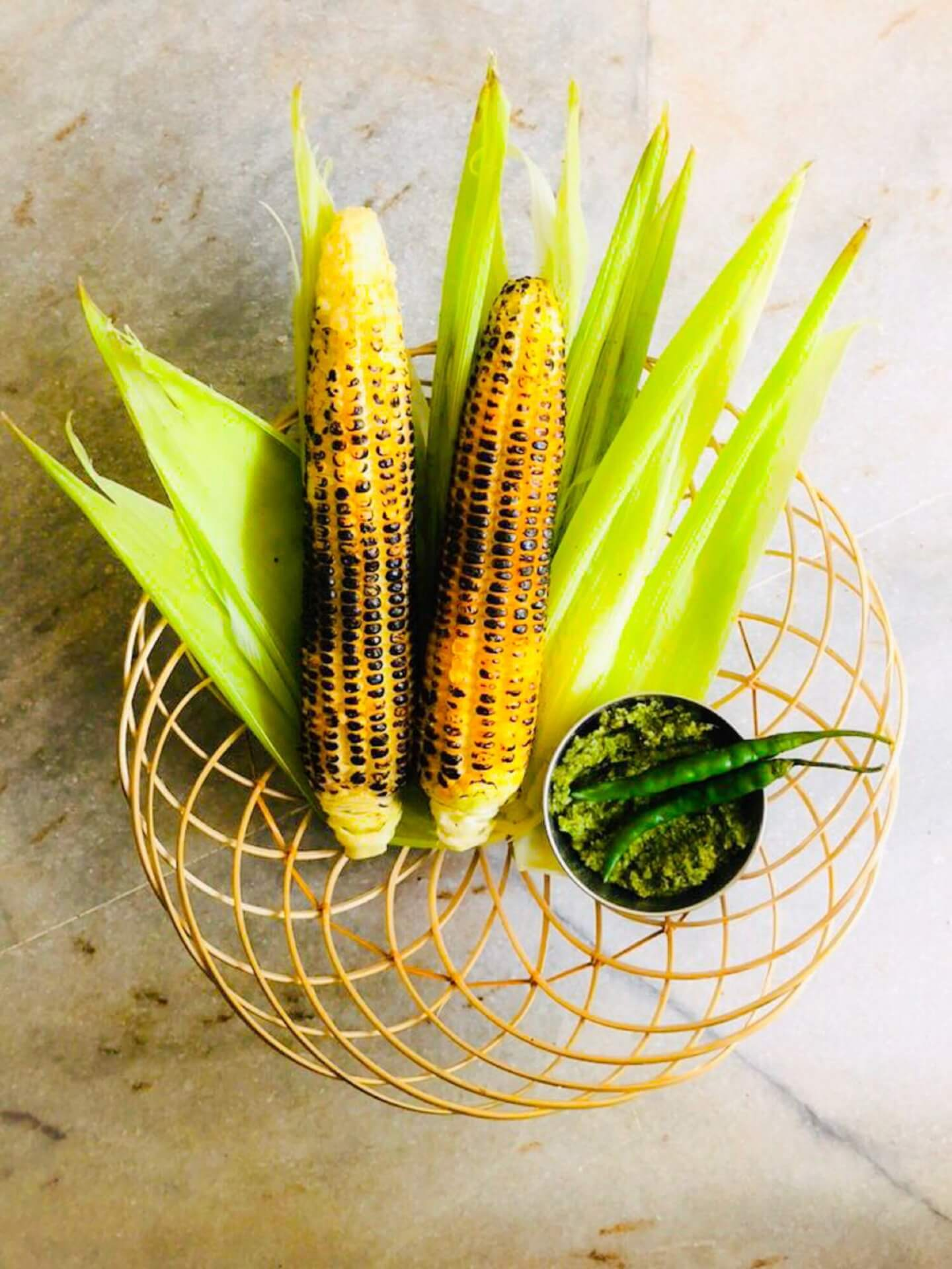 Fire cooked corn on the cob with spicy chilli-mint chutney